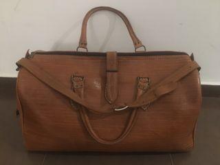 Maleta, bolso, equipaje de viaje cuero