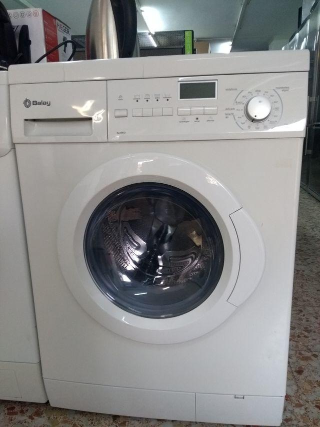 Lavadora secadora 6/4kg