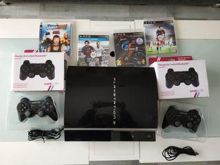 PS3 con mandos y juegos