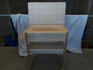 Cambiador para bebés con bañera