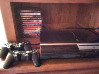 Ps3, dos mandos, catorce juegos y accesorios
