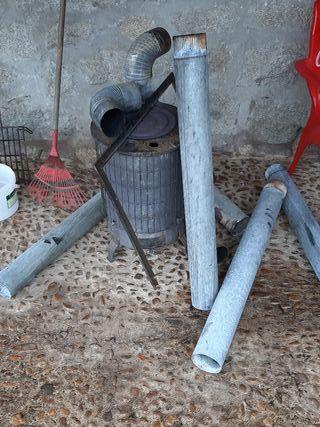 estufa de leña de hierro fundido y tubos