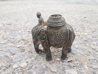 mortero y elefante de bronce