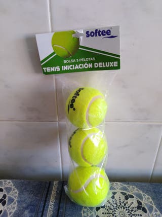 tres pelotas de tenis