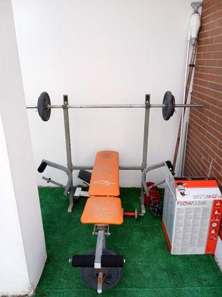 maquina musculacion y pesas