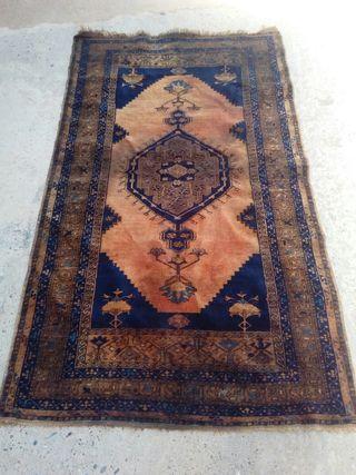 Antigua alfombra persa anudada a mano