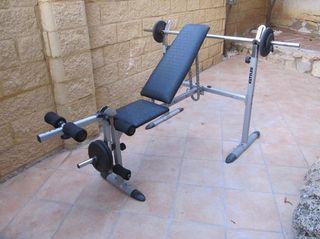 Banco de gimnasia + pesas
