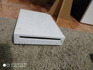 Wii con 2 mandos, juegos y accesorios