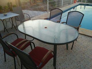 Mesa de jardín con 4 sillones