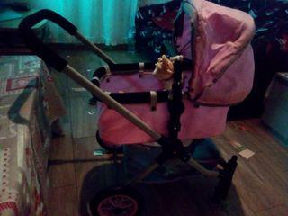 se vende carrito de muñecas