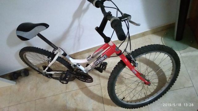 "sé vende bicicleta 24""."