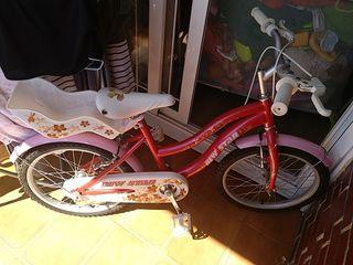 bicicleta niña con cesta para muñecas
