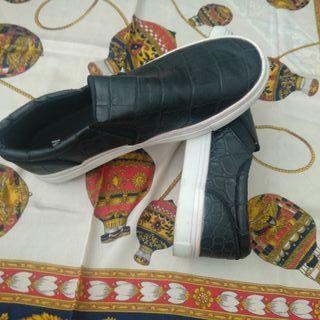 Zapatillas slip on estampado serpiente