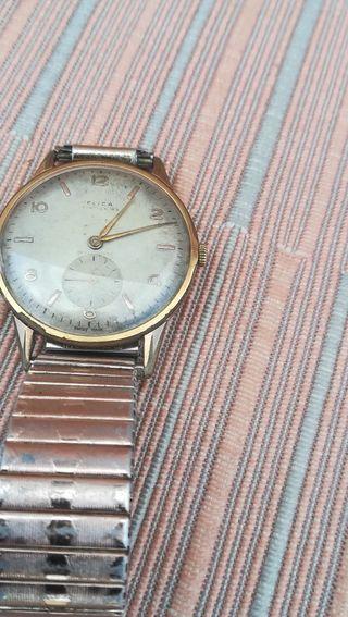 antiguo reloj suizo Flica