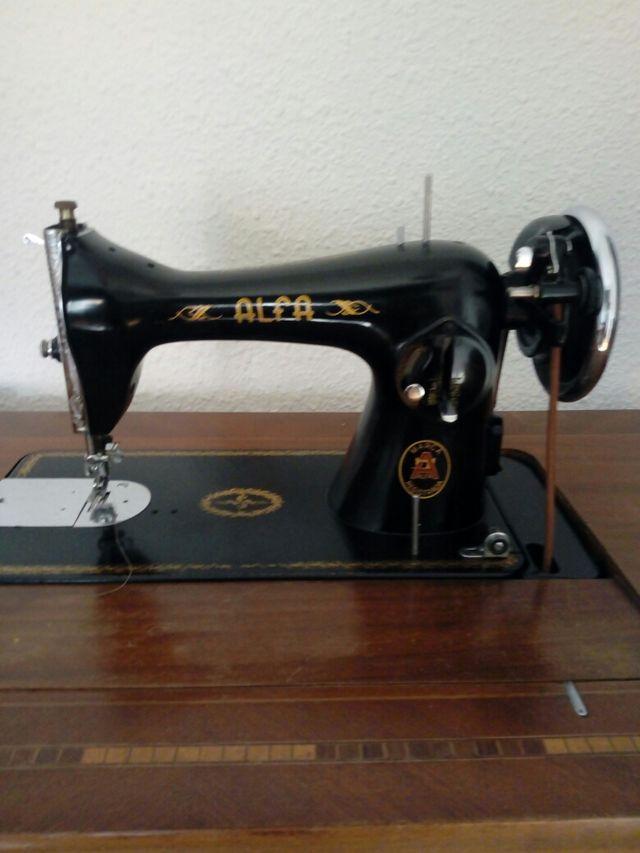 maquina de coser antigua solo la cabeza