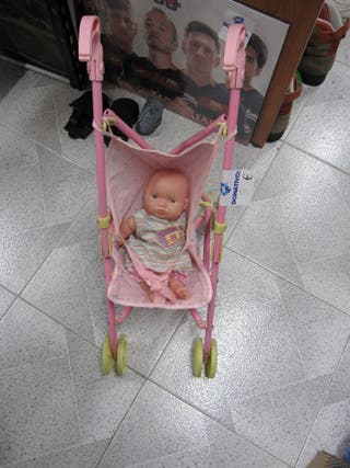 Carrito muñecas con muñeco