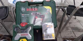 taladro Bosch electrica con dos cajas de brocas