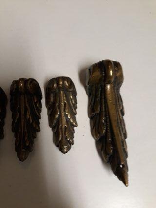 Embellecedores de bronce antiguos.6
