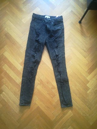 Pantalones vaqueros negros rotos nuevos