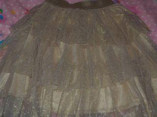 Falda de volantes dorada