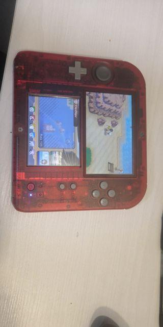 nintendo 2ds con dos juegos pantalla inferior rota