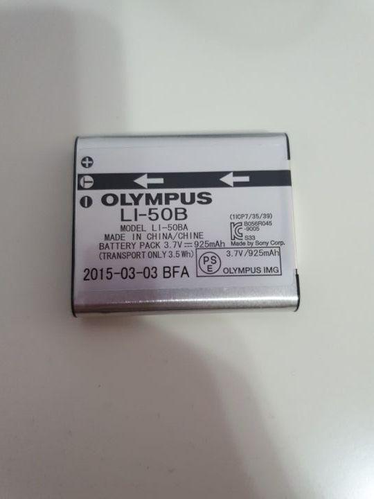 batería + cable olympus + cargador + funda
