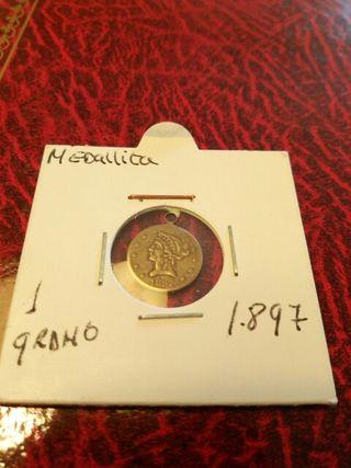Medallita ( moneda) antigua