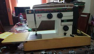 Máquina de coser alfa con discos para bordar.
