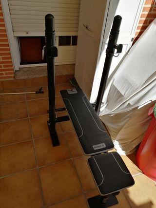 Banco de pesas + barra y discos.