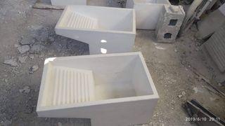 pilas de lavar, pilones y fregaderos