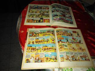 2 cómics uno de Astetix y uno de Tom Sawyer
