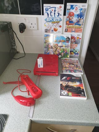 red Wii plus 7 games and HDMI converter