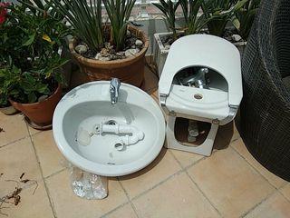 lavabo y bidet con grifería en perfecto estado