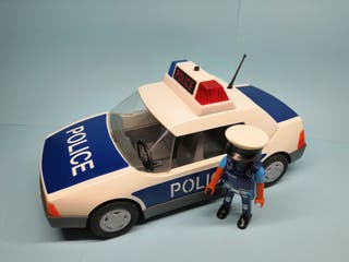 Coche de policia con agente de Playmobil