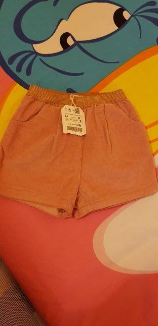 Pantalón corto niña rosa claro