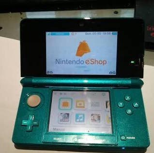Nintendo 3DS azul y juegos
