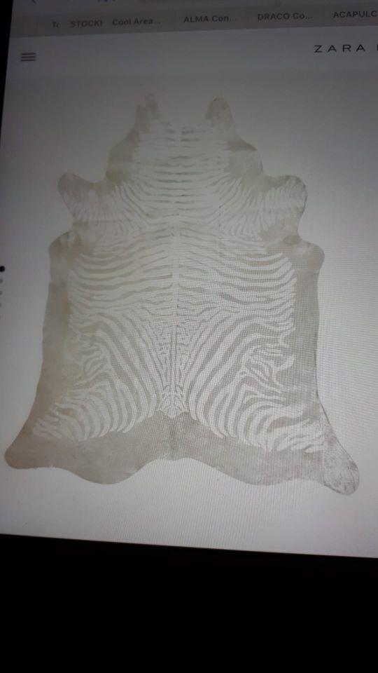 Alfombra piel cebra en tonos plata