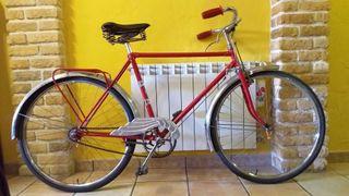 bicicleta antigua de frenos de varillas