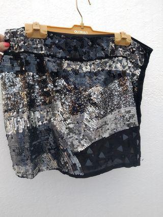 Minifalda con pedrería negra y plateada. Talla M
