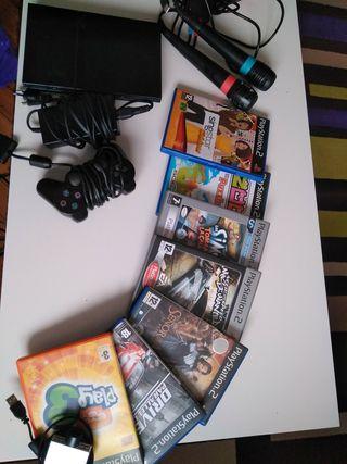 Lote PlayStation 2 + juegos con accesorios.