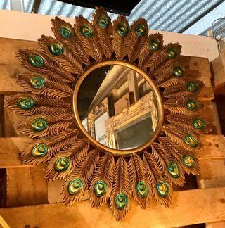 Espejo plumas