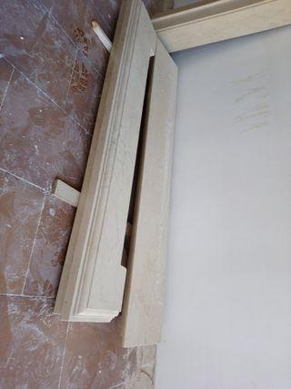 portal chimenea en mármol tallado