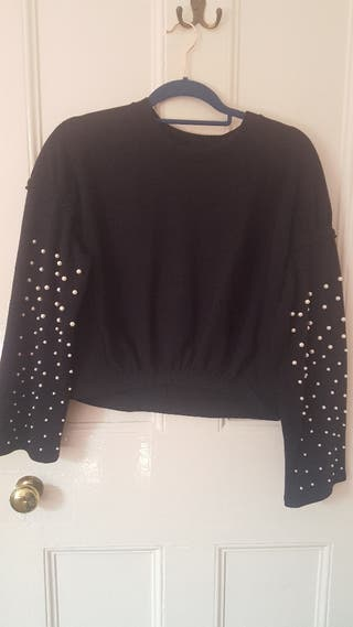 black sweater with pearls