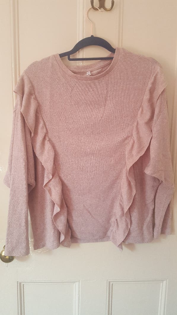 pink frilly sweater