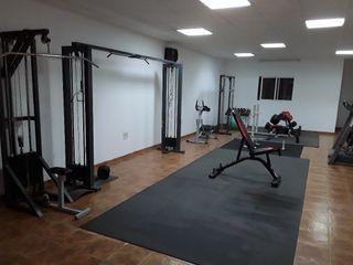 cruce de polea, maquina gimnasio