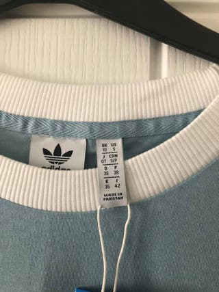 Woman's Adidas 3 stripes
