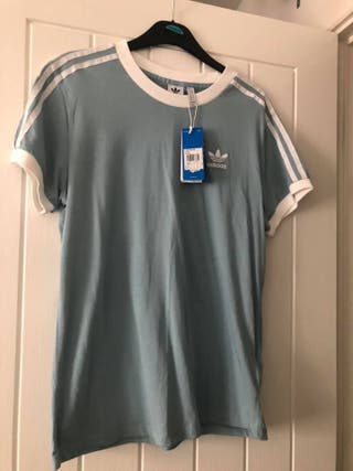 Woman's Adidas 3 stripes