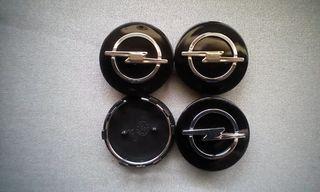 4 Tapabujes centro de rueda opel negro plata 59mm.