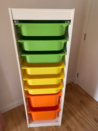 Ikea cupboard with colorful boxes