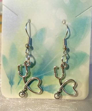 Brand new pierced earrings in package